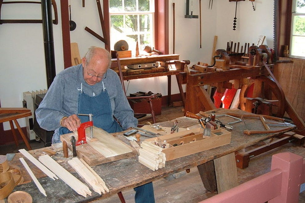 A craftsman in Pleasant Hill constructs traditional Shaker boxes.