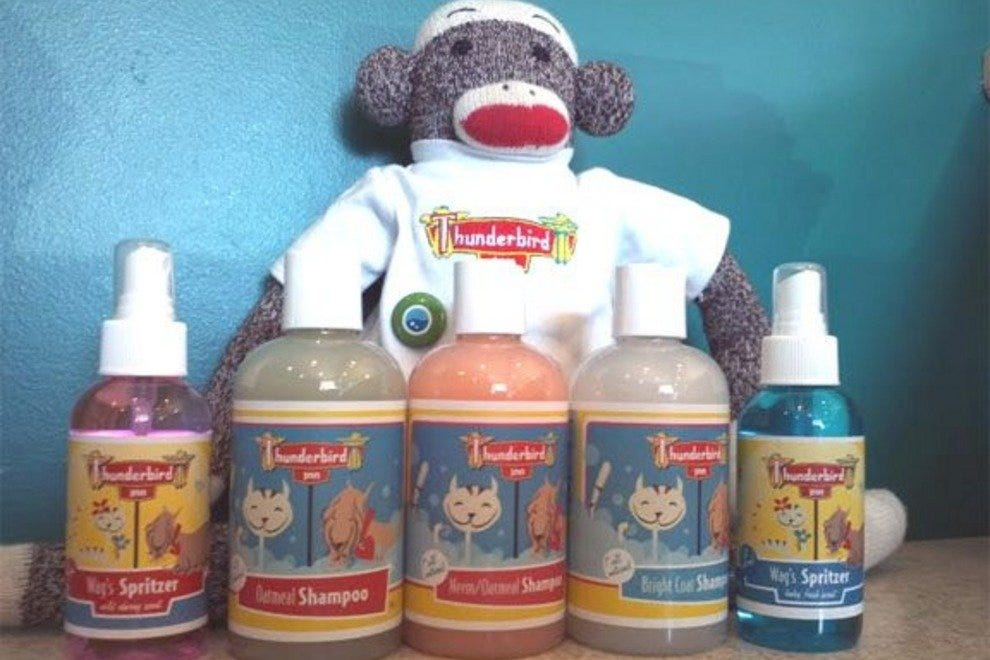 George the sock monkey poses with the Thunderbird Inn's line of all-natural pet care products.