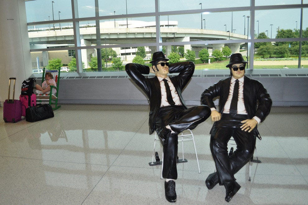 Pose with the Blues Brothers in Chicago's airport.