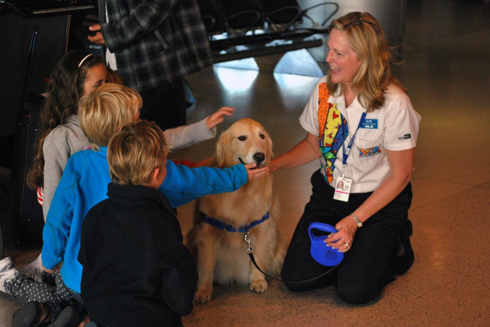 Casey brings smiles to passengers passing through Miami International.