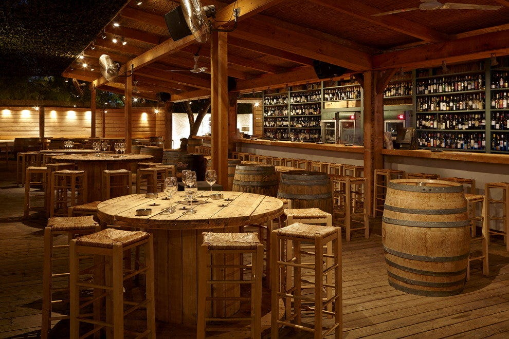 Barrel shaped tables at Fabrica de Vino in the Sand
