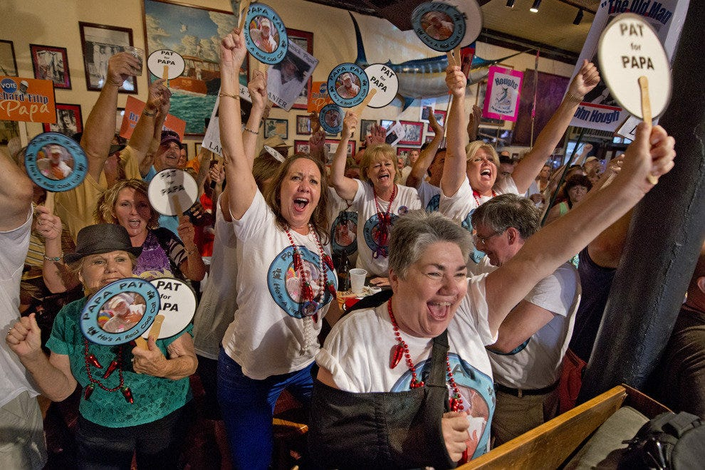 Supporters of Pat Lanier cheer him on during the Look-Alike Contest at Sloppy Joe's.