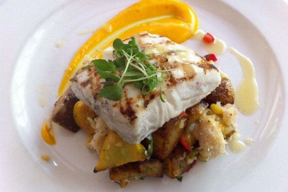 Grilled halibut with a crab and pepper hash and saffron aioli