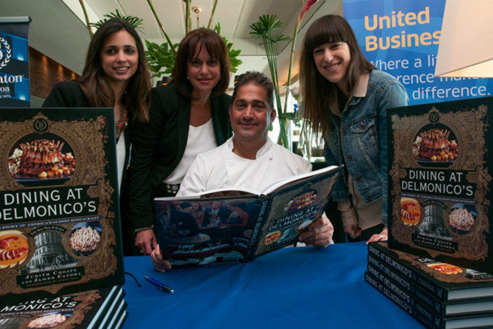 Chef Jimmy signs copies of his book 'Dining at Delmonico's' after the lunch.