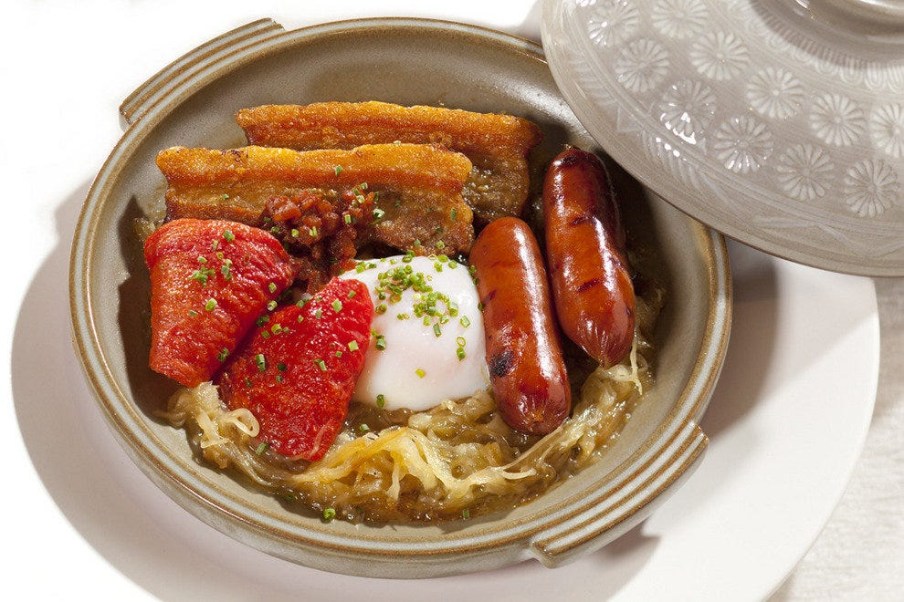 The Breakfast Toban-Yaki, one of the items on Nobu's first in-room dining menu: Kurobuta sausage, onsen egg, onion, crisp pork belly and roasted tomato