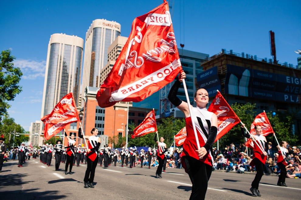 Flag wavers march in the Stampede Parade