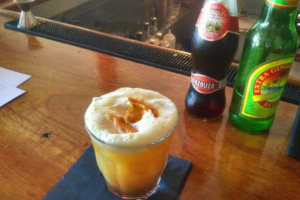 The tamarind fizz with housemade, crisp candied orange garnish is delicious