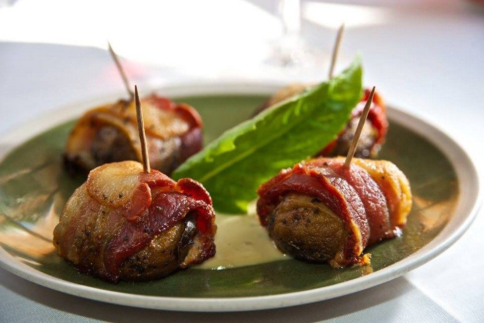 Bacon- and basil -wrapped mushrooms with basil aioli.
