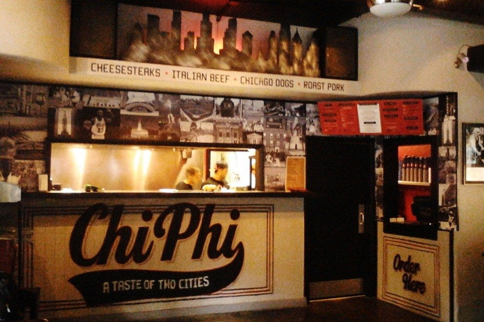 "The kitchen and order window at Chi Phi (pronounced ""Shy-Fy"")."