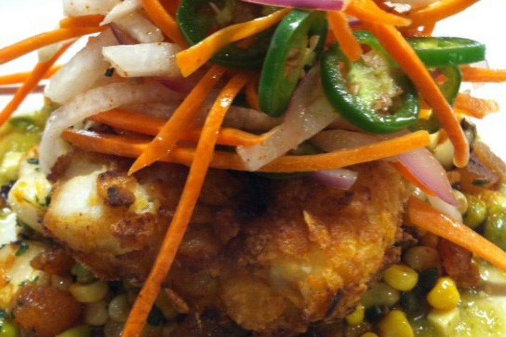 Corn flake and sweet corn-crusted lane snapper with edamame succotash,tomatillo avocado broth and coriander salad
