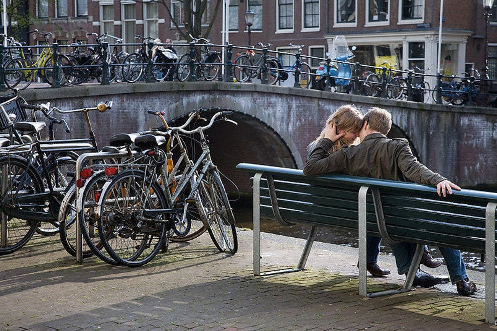 A couple by an Amsterdam canal