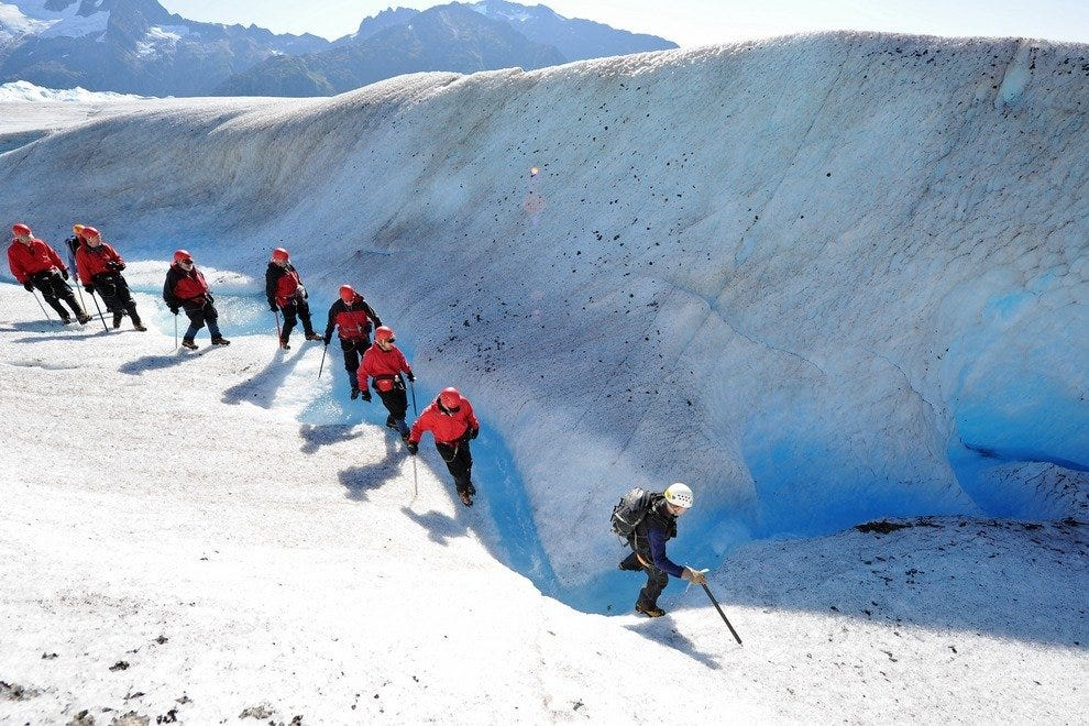 Walking on a glacier is other-worldly, with blue ice glowing like neon.