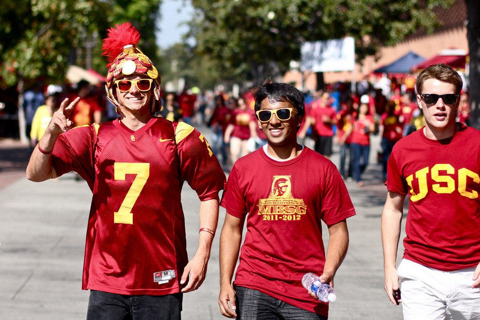 USC Trojans fans on the way to a tailgate