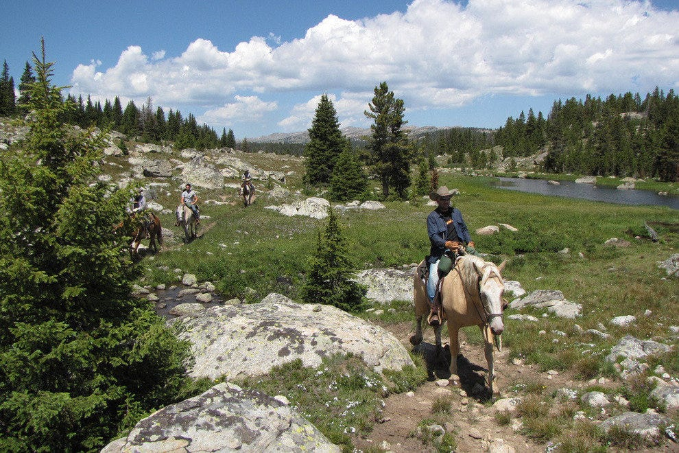 Trail ride with a Wyoming dude ranch