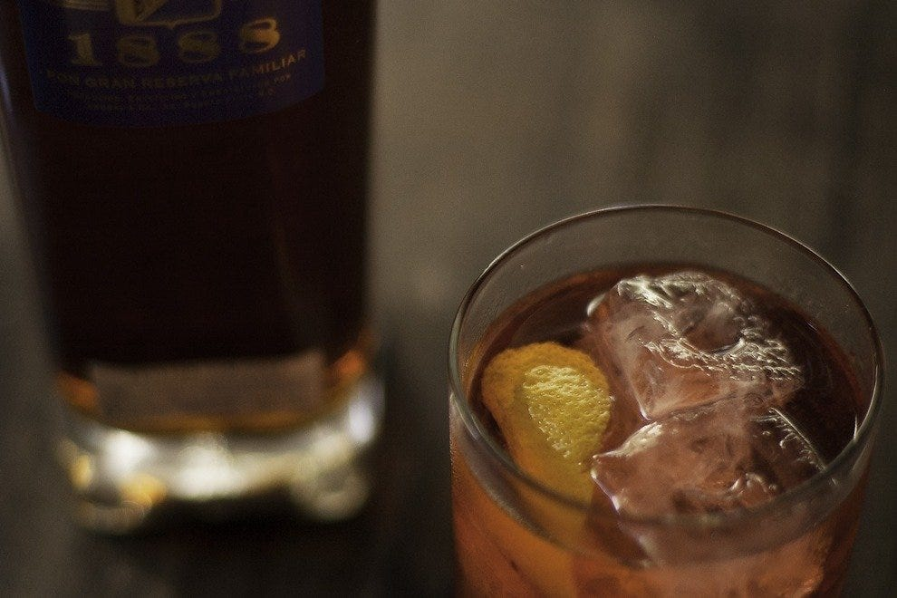 Courtesy mixologists give the classic Negroni cocktail a rum spin with Brugal 1888