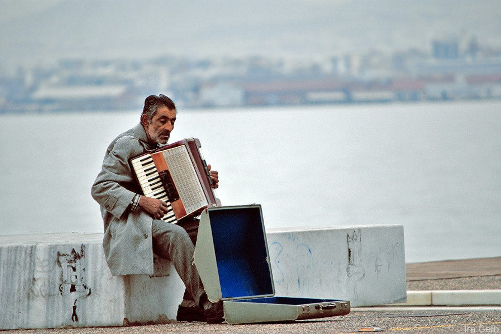 A street musician plays the accordian on the Thessaloniki waterfront.