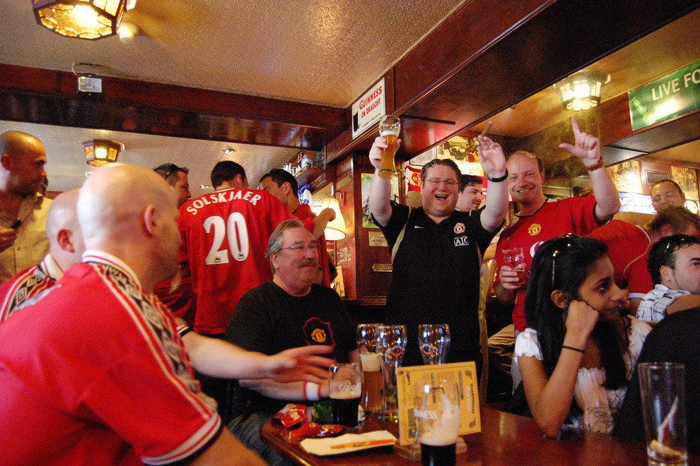 Manchester United fans gather for a post-match drink