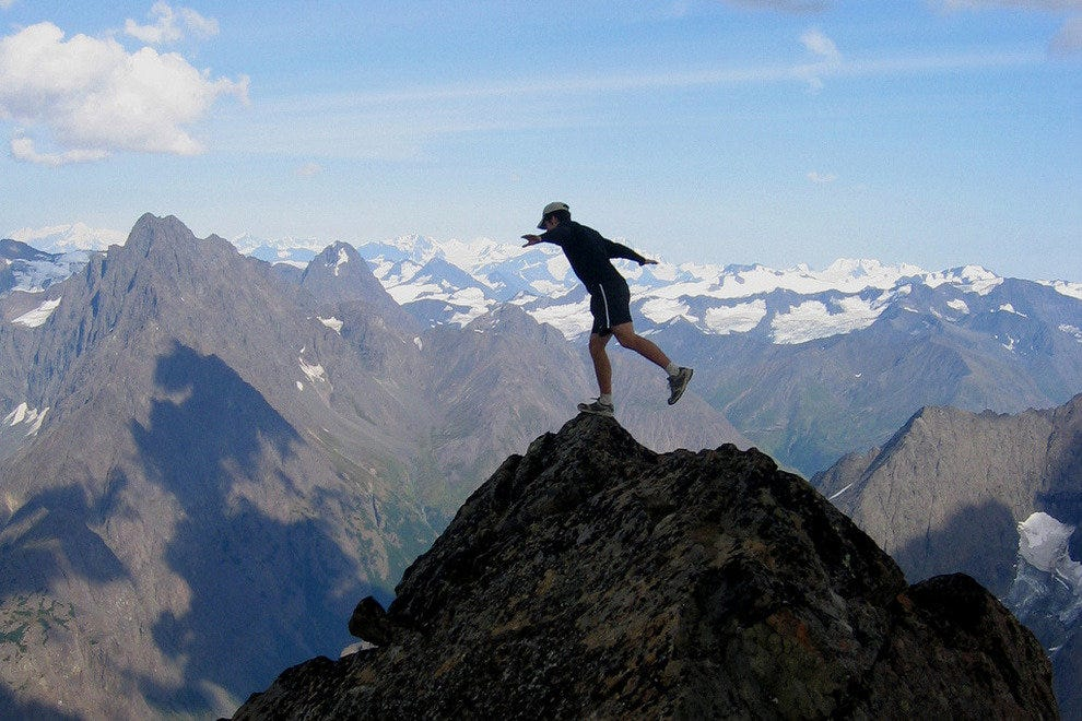 Balancing atop Eagle Peak Summit in the Chugach Mountains