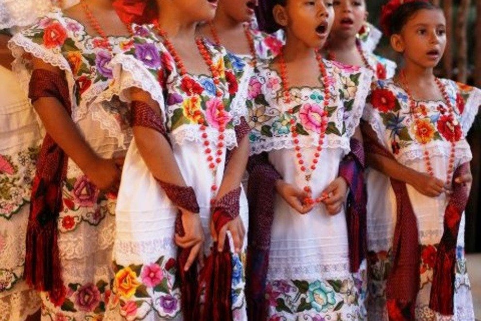Young girls wearing ceremonial huipiles