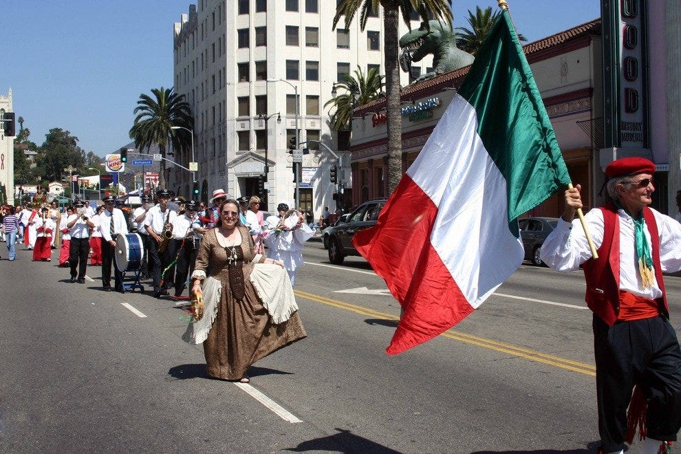 Italian bands parade through the streets of Hollywood as part of the San Gennaro Festival opening ceremonies.