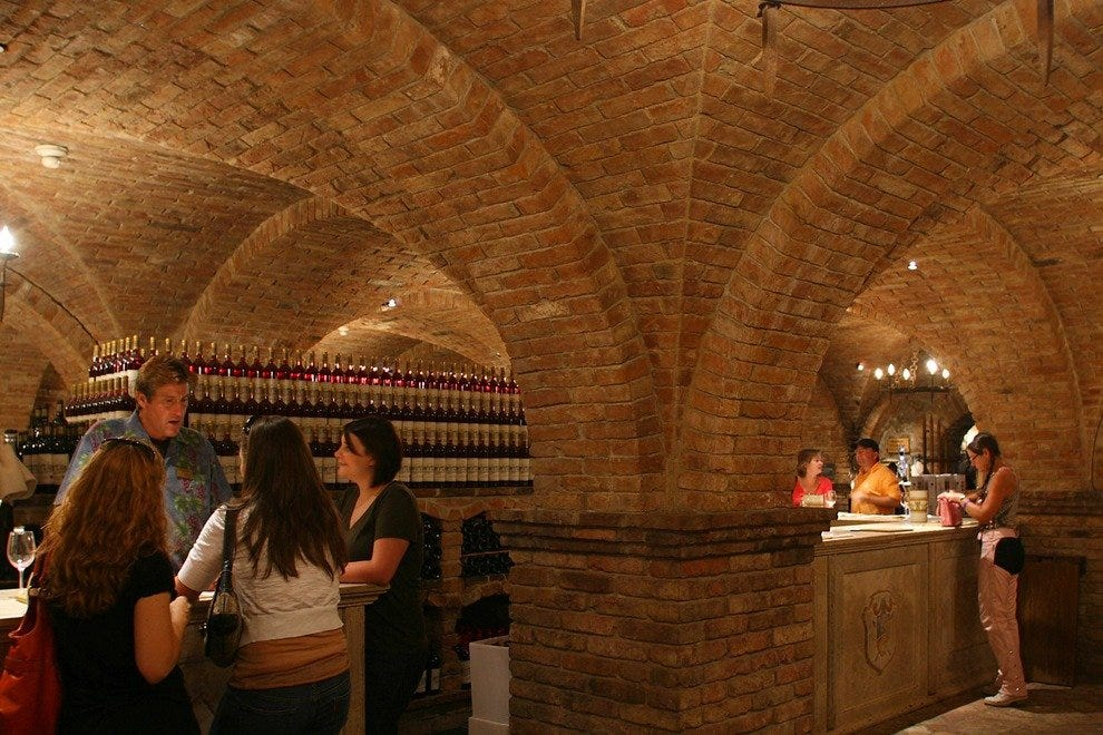 Guests savor a variety of premium wines produced at the Castello.