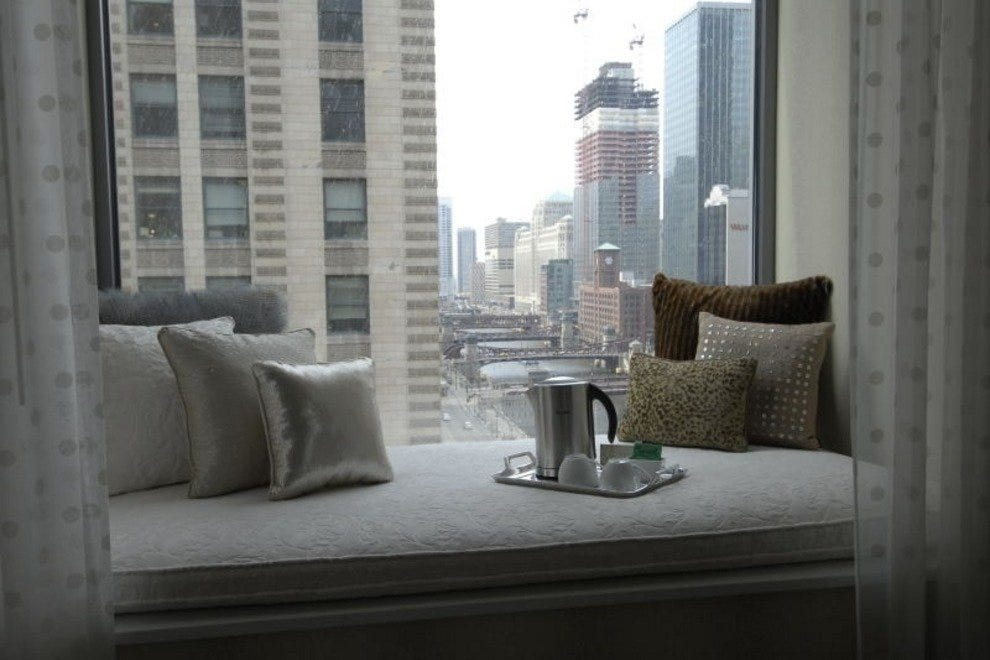 The Tranquility Suite at Hotel Monaco Chicago, with a one of a kind window seat