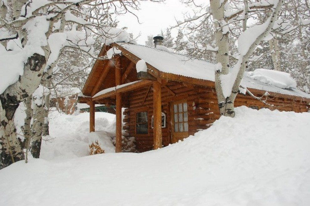 One of the Sorensen's Resort cabins in the snow