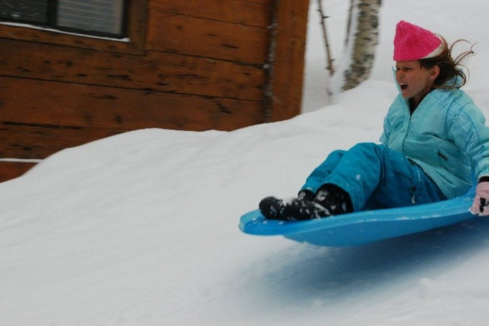 Sledding on one of Sorensen Resort's hills
