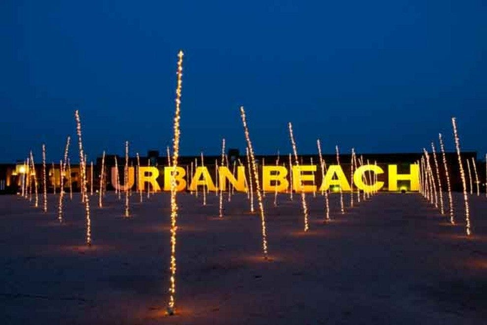 "The facade of Urban Beach, complete with ""sand"" and ""palm"" plantation"