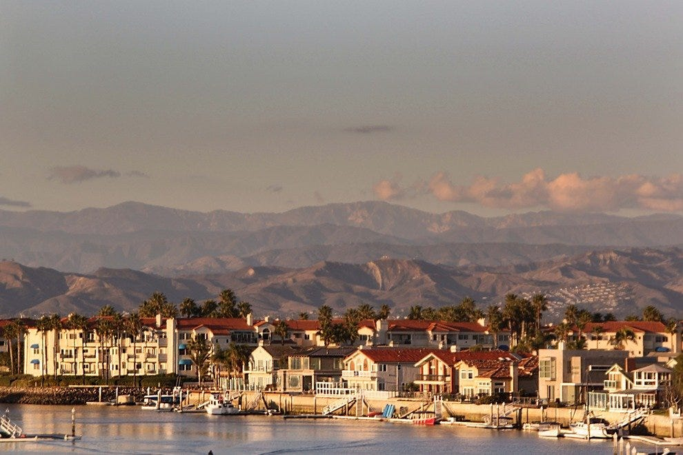 The city of Oxnard stretches out from the coast towards the Santa Monica mountains.
