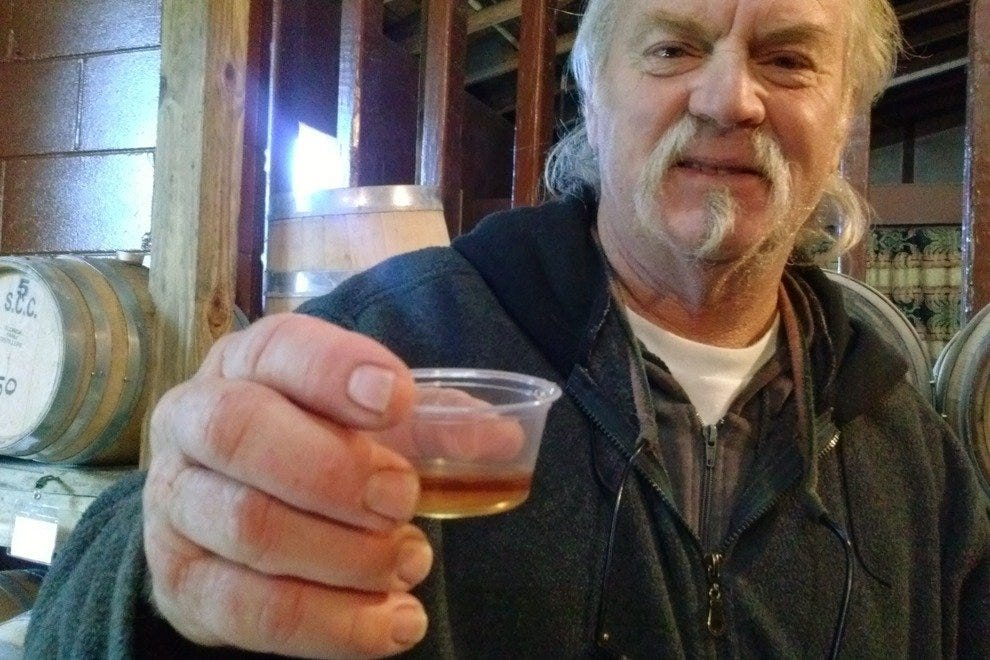 "Dick Waters offers up a sample of ""first trimester"" whiskey, three months aged."