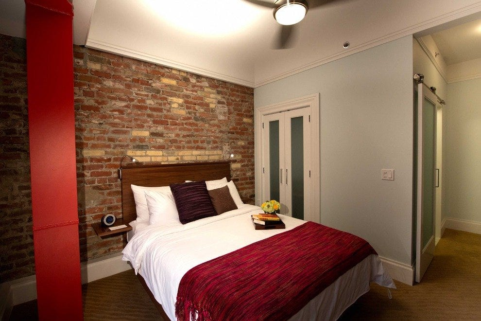 The exposed brick in the hotel's standard rooms is part of the original 1906 building