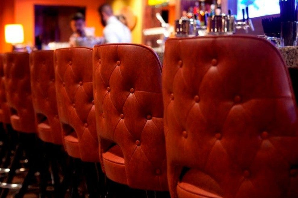 Take a seat at the bar or in one of the half-moon booths at Punch House