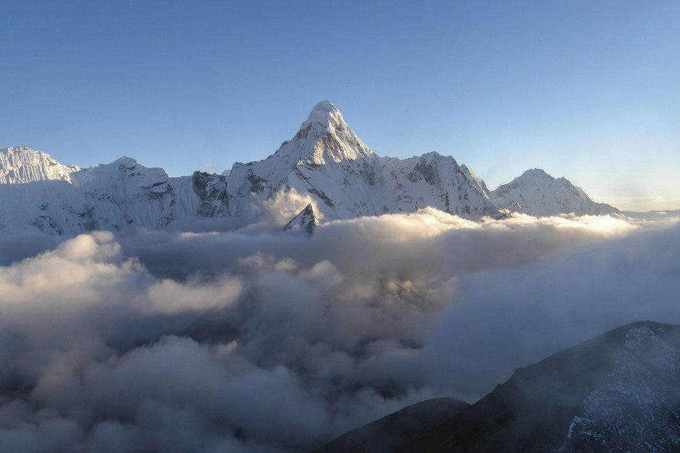 Mount Everest rises above the clouds