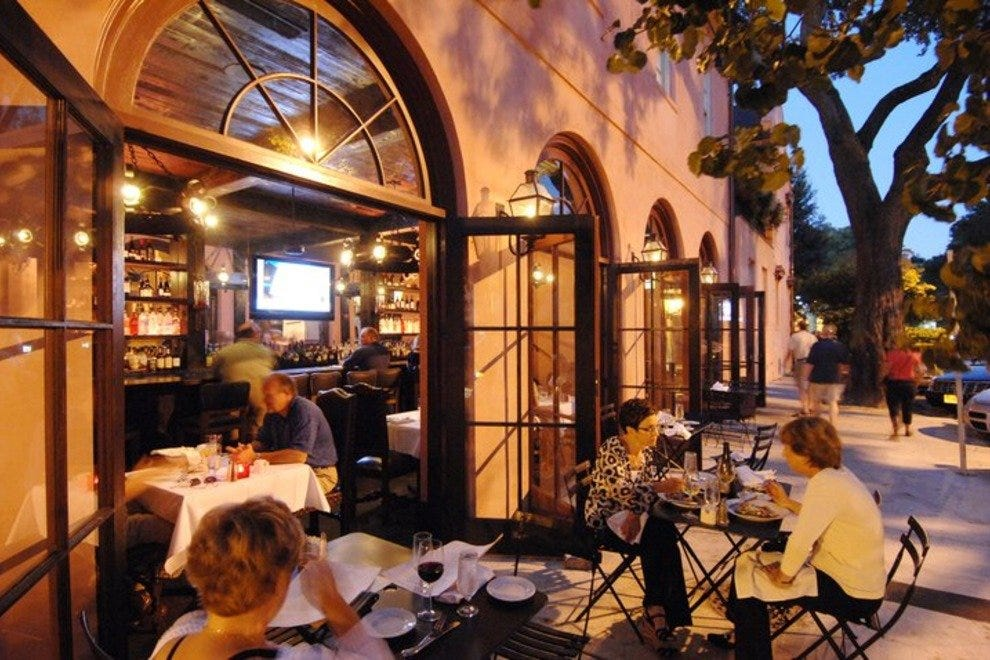 Mood-setting outdoor dining at The Olde Pink House