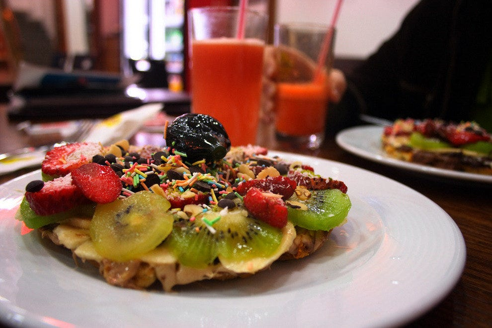 A sweet waffle bursting with fruits, nuts and creamy spreads.
