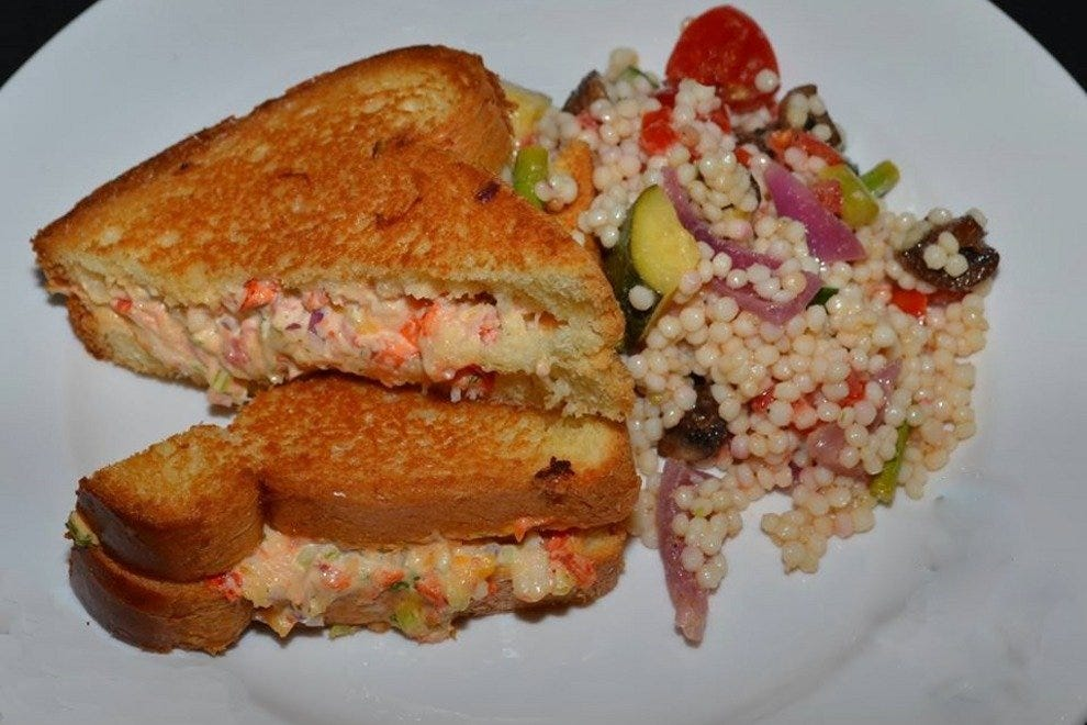 Lobster melt with pimento cheese on brioche and vegetable pasta salad on the side