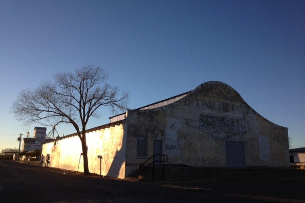 Sunset casts shadows on Marfa's old buildings.