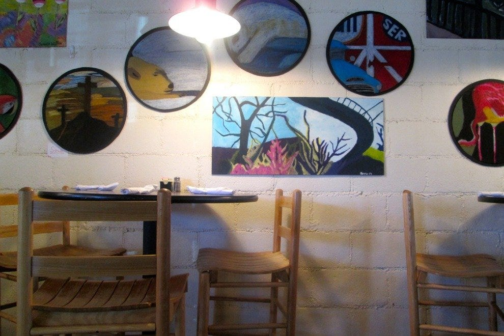 Local artwork decorates the walls of the dining area, and most pieces are for sale, too