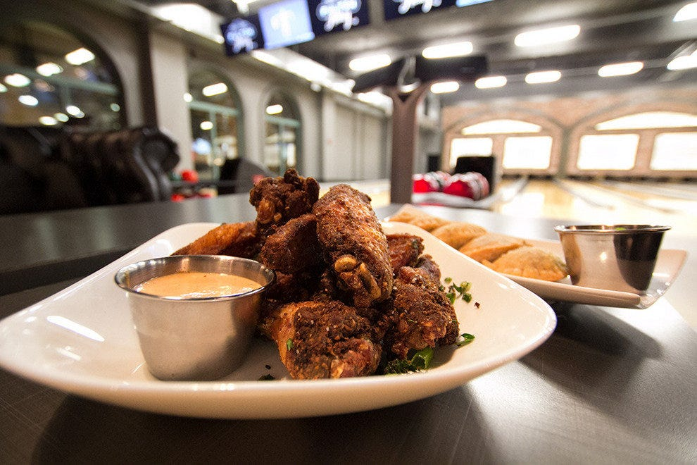 Chef Mike Nirenberg cooks up a fun menu of modern Southern comfort food like these smoked wings at Fulton Alley.