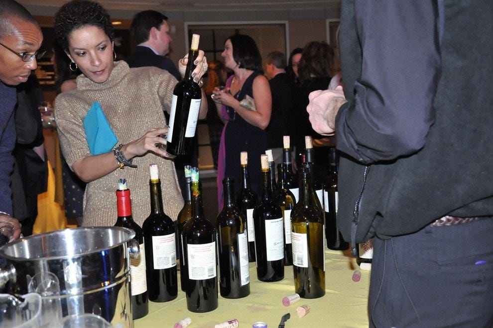 Partygoers check out the boutique wines at a Wine+Food series event.