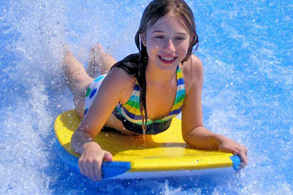 A body boarder takes on the FlowRider.