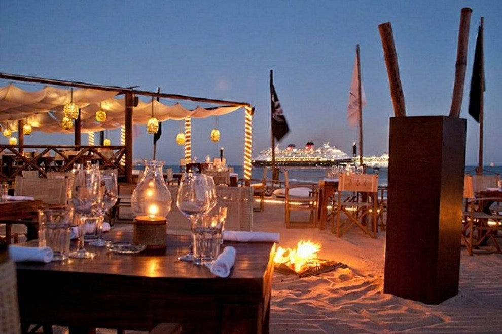 Beachside tables offer beautiful views of Land's End and the cruise ships that lay at anchor in the bay.