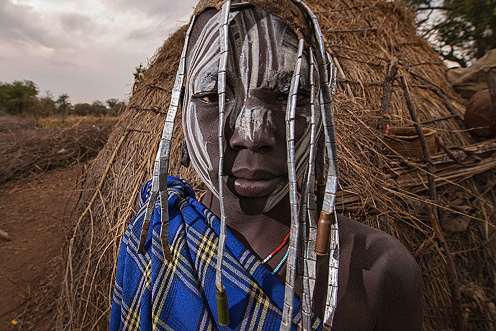 Mursi boy with watch band jewellery