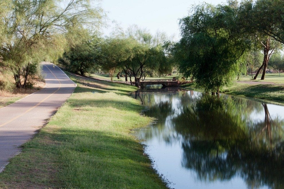 The Scottsdale Greenbelt bike path winds around several man-made lakes