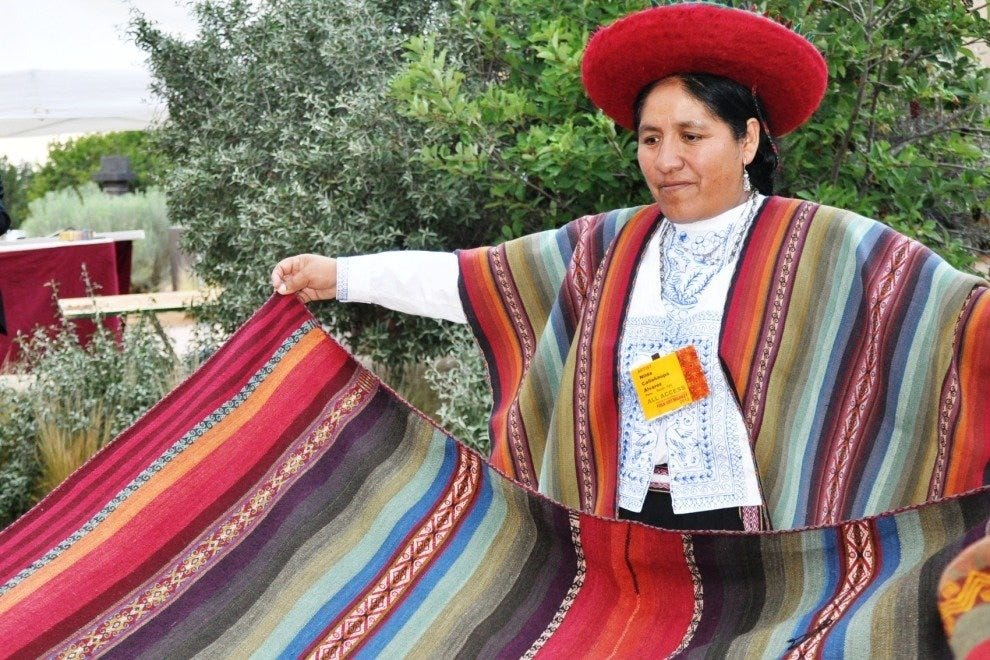 A Peruvian artisan with her handiwork at the Santa Fe International Folk Art Market
