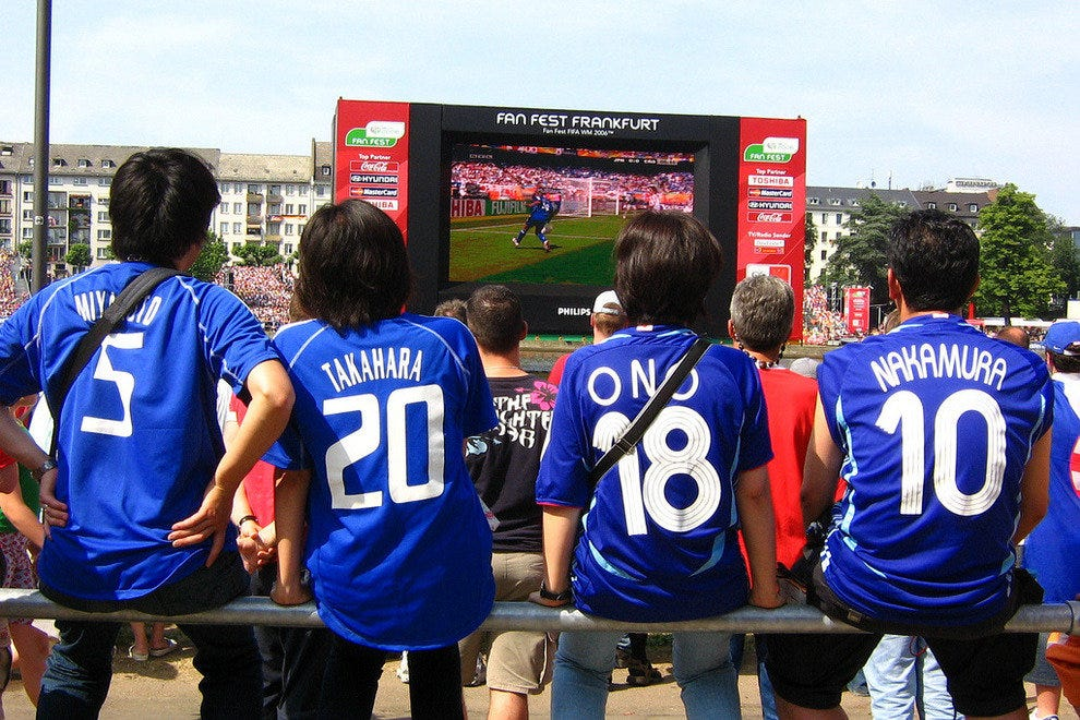 Soccer fans attend a Fan Fest at a previous World Cup