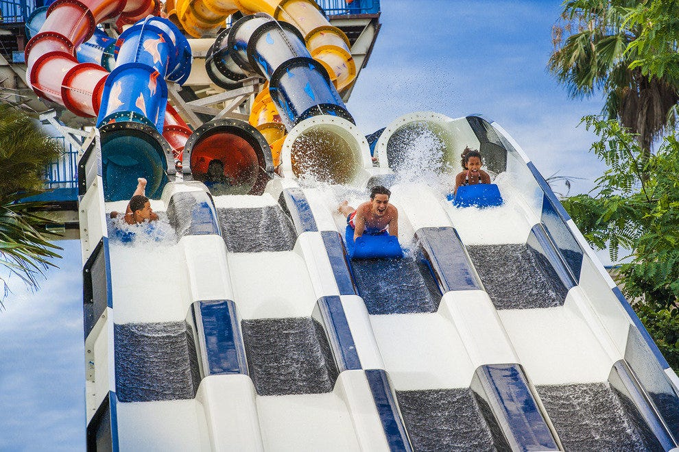 Friends and family compete for bragging rights on the Aqua Drag Racer at Orlando's Wet 'n' Wild water park