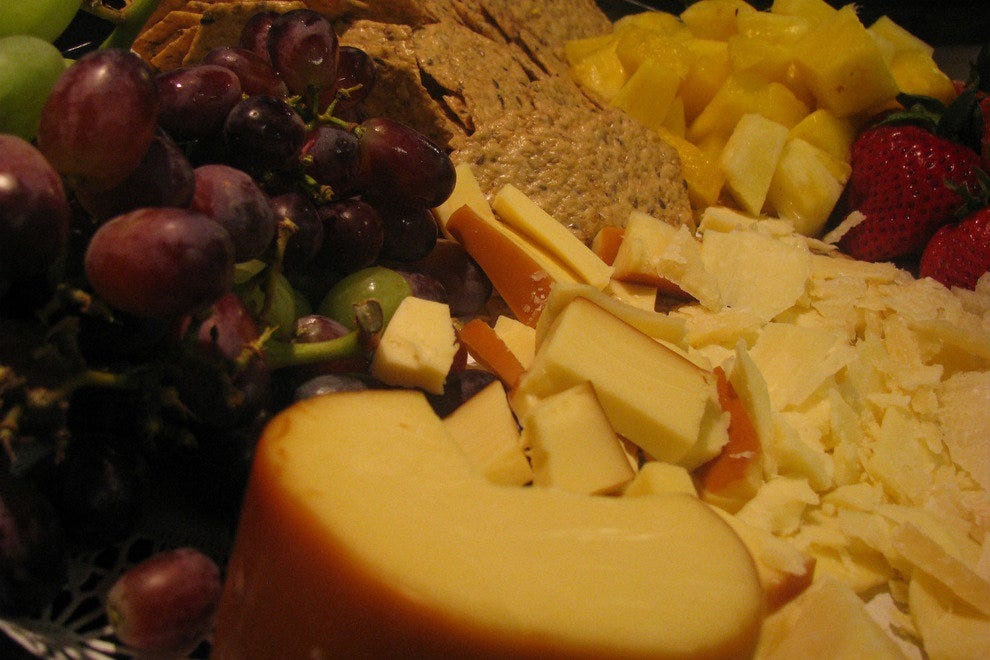 A fruit and cheese platter is an excellent complement to a glass of wine
