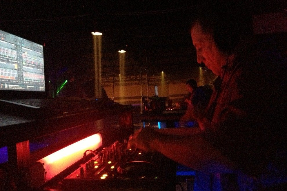 Art Rooney spins the hottest dance tunes in the elevated DJ booth at TBL